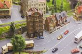 Miniature City Made As A Mockup. Busy Traffic. City Street. Weekday In A Big Metropolis. A Tree In T poster