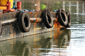 stock photo of coal barge  - Side Details of a Barge Boat in Calm Water - JPG