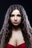 picture of black curly hair  - Young beautiful serious girl with curly hair look at camera - JPG