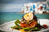 image of cheese platter  - Prawn starter with aubergine tomato and salad by the sea in Mykonos Greece - JPG