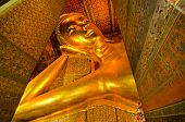 stock photo of recliner  - Reclining golden Buddha Wat Pho Bangkok Thailand - JPG