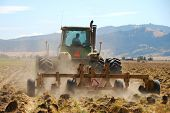 stock photo of plowed field  - Plowing the field in preparation for Winter Wheat in the Willamette Valley between Eugene and Albany Oregon - JPG