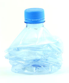 stock photo of plastic bottle  - a compressed plastic water bottle - JPG