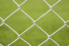 picture of barbed wire fence  - Seamless Wire Fence With Green Field Background - JPG