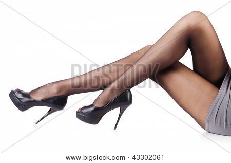 Woman with tall legs isolated on white