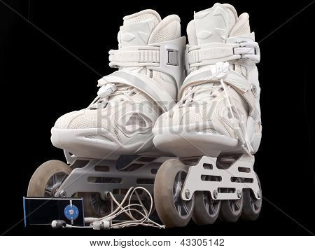 Roller Skates And Mp3 Player With Headphones