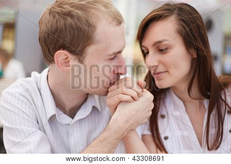 Young Man Kissing Hand Of His Girlfriend On Date