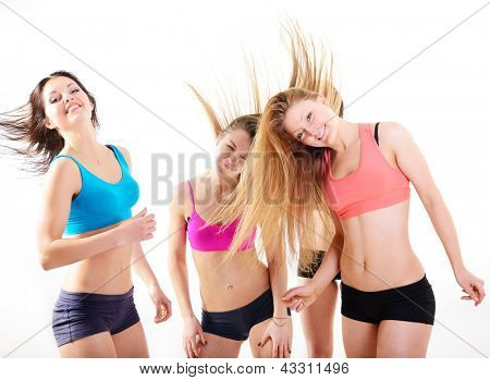 group of happy fitness teen girls have fun, dancing and jumping, over white background