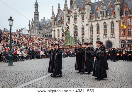BRUGES, BELGIUM - MAY 17: Annual Procession of the Holy Blood on Ascension Day. Locals carry statue of the Virgin Mary. May 17, 2012 in Bruges (Brugge), Belgium