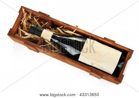 Bottle of old red wine in gift wooden box, isolated on white