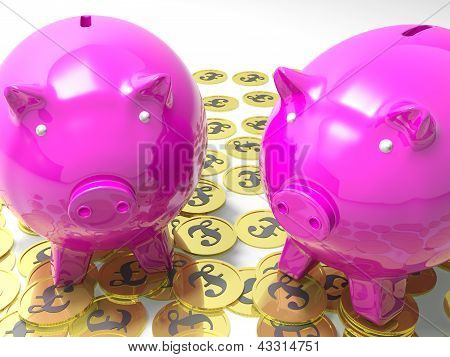 Piggybanks On Pound Coins Shows Wealthy Savings