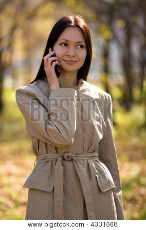 Pretty Brunette Girl On Cellphone