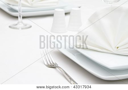 Place settings with white plates
