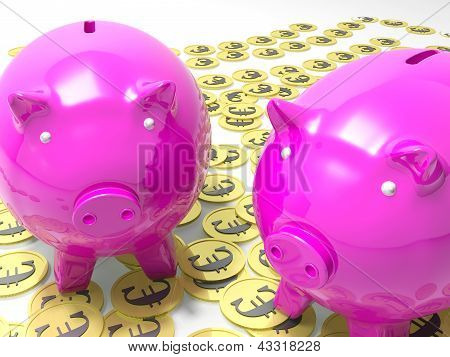 Piggybanks On Euro Coins Showing European Savings