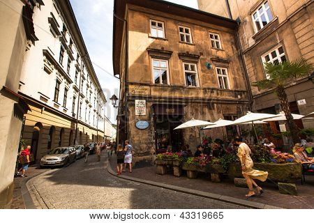 KRAKOW, POLAND - JULY 18: One of the streets in historical center of Krakow, May 18, 2012 in Krakow, Poland. This year the city was visited by 8.1 million tourists, which is the highest level.