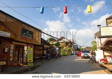 PAI, THAILAND - JAN 2: Street scene in Pai on Jan 2, 2013 in Pai, Thailand. During high season, tourist numbers swell to the point where Pai experiences as shortages of electricity, water and petrol.