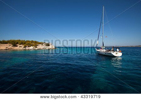 "SARONIC GULF, GREECE - SEPTEMBER 27: Competitors boats during of sailing regatta ""Viva Greece 2012"" on September 27, 2012 on Saronic Gulf, Greece."