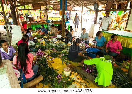 KO CHANG, THAILAND - NOV 28: Local people make krathong for Loy Krathong festival, Nov 28, 2012 on Chang, Thailand. Loi Krathong takes place annually on the evening of the full moon of the 12th month.