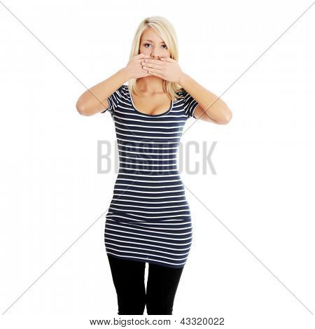 Young beautiful blond woman covering her mouth with hands, isolated on white background. Freedom of speech concept