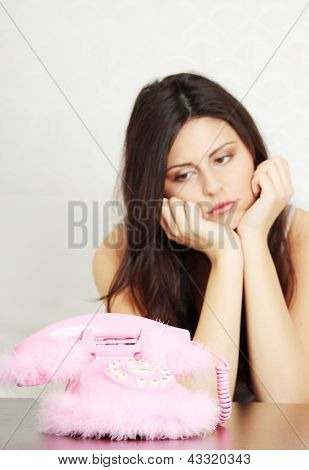 Young beautiful woman waiting for call