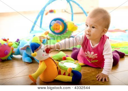 Baby Playing At Home