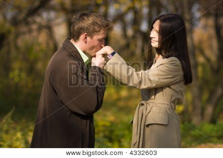 Young Romantic Man Kissing Girls Hand