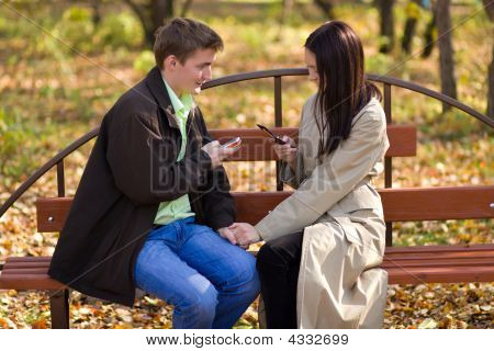 Young Couple With Mobile Phones