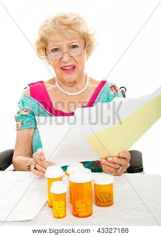Disabled senior woman frustrated by the cost of prescription drugs and other medical expenses.  White background.
