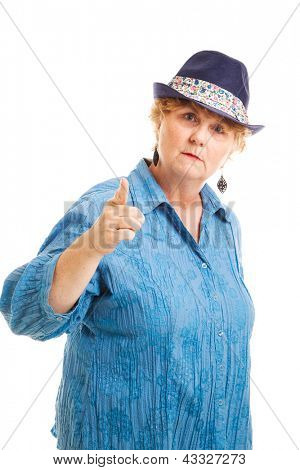 Middle aged woman pointing her finger in a bossy, scolding gesture.  Isolated on white.