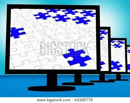 Puzzle inacabado en monitores mostrando perdido piezas