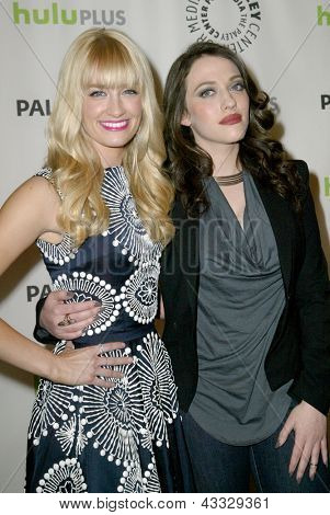 BEVERLY HILLS - MARCH 14: Beth Behrs and Kat Dennings arrive at the 2013 Paleyfest