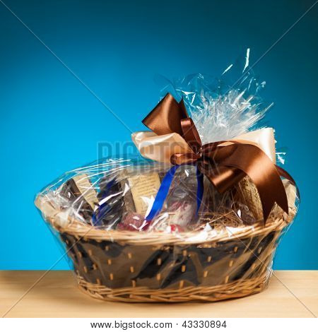 gift in a basket against blue background