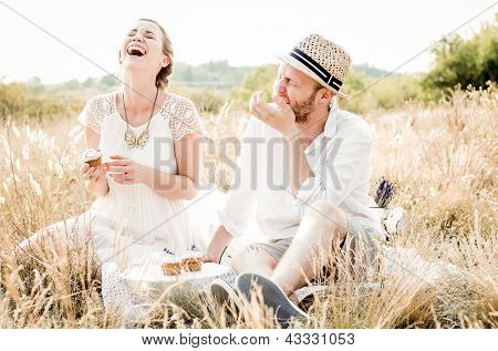 Happy couple embracing and laughing