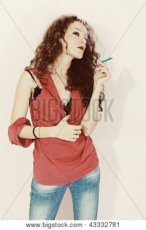 Smoking Young Brunette Woman With Long Curly Hair