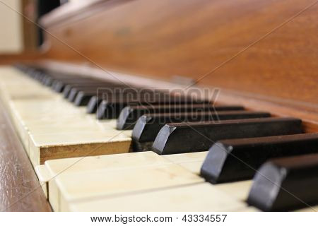 Piano keys of an old traditional piano instrument