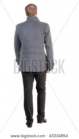 Back view of going  handsome business man in coat.  walking young businessman . trendy businessman in outerwear. Rear view people collection.  backside view of person.  Isolated over white background.