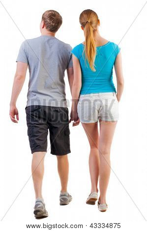 Back view of walking  young couple (man and woman). young husband and wife walk. man watches with interest that it. Rear view people collection. backside view of person. Isolated over white background