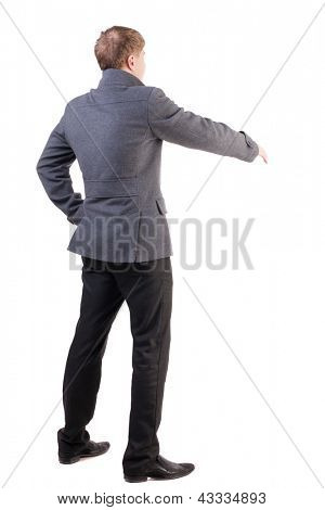 back view of businessman in coat reaches out to shake hands. Rear view people collection. backside view of person. greeting guy in autumn clothes. Isolated over white background.