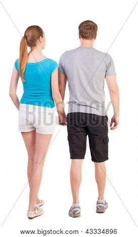 Back view of young couple (man and woman) dressed for summer travel a couple of young people. beautiful friendly girl and guy together. Rear view. Isolated over white background.