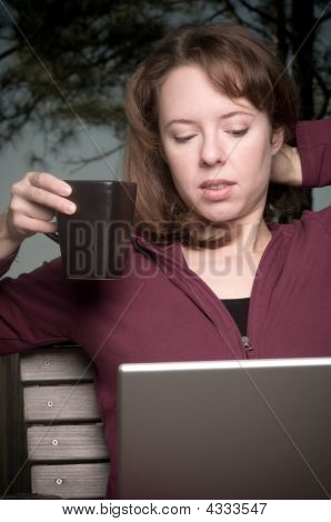 Young Woman With Cofee And Laptop