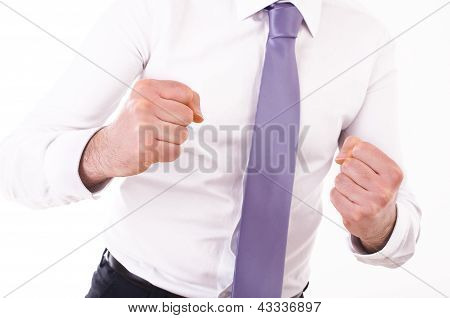 Business man punching the air.