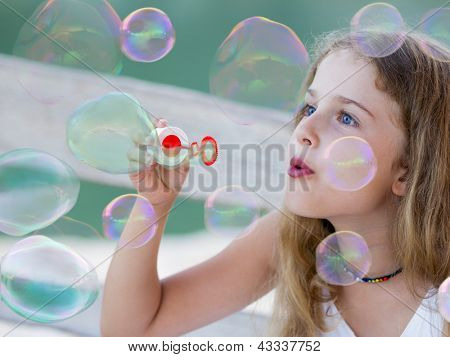 Summer joy, happy child - Soap bubbles - lovely girl blowing bubbles