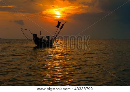 Sea boat art photography. Sunset sun with dramatic clouds