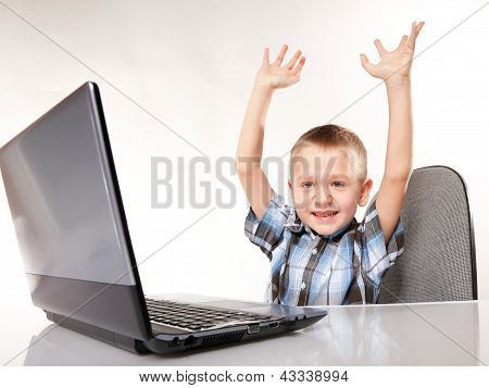 Triumphing Child With A Laptop Computer Isolated