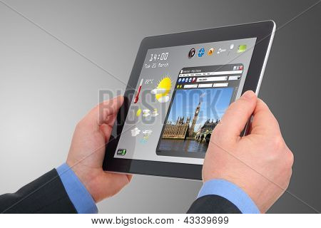 a businessman searching a tourism information on pad