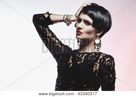 Sexy Fashionl Woman In Black Guipure Dress. Professional Makeup And Hairstyle