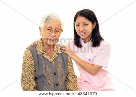 A nurse and elderly lady