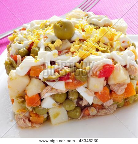 closeup of a plate with ensaladilla rusa, russian salad, typical tapas in Spain
