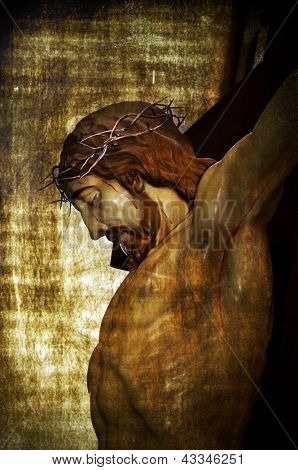 Jesus Christ on the Holy Cross on a vintage background