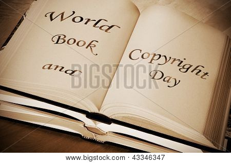 sentence world book and copyright day, celebrated each year on april 23, written on an open book
